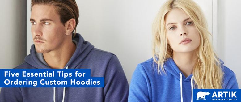 Two people wear custom printed sweatshirts and hoodies