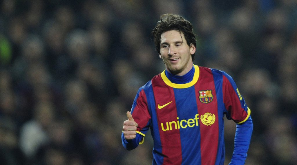 FC Barcelona's Lionel Messi from Argentina gives a thumbs-up against Atletico Madrid during their Spanish La Liga soccer match at the Camp Nou stadium in Barcelona, Spain, Saturday, Feb. 5, 2011. (AP Photo/Manu Fernandez)