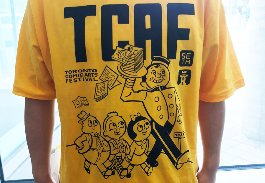 A photo of the TCAF shirt being worn by an event volunteer