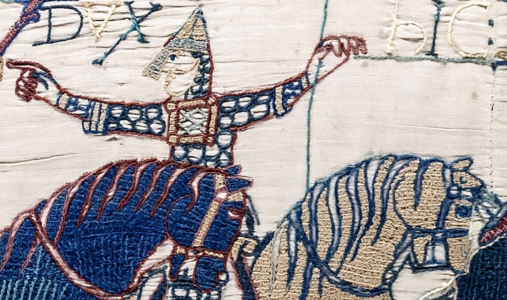 Photo: By Myrabella (Own work) [Public domain or CC0], via Wikimedia Commons Bayeux Embroidery, created in the 11th century. Measuring about 230 feet long, this section is of scenes 55 and 56.