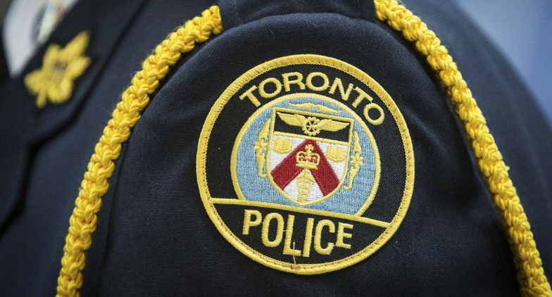 A police officer in Toronto wearing an embroidered crest on their uniform